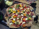 Pizza fresh from the Garden, including being cooked in the garden, on the BBQ grill